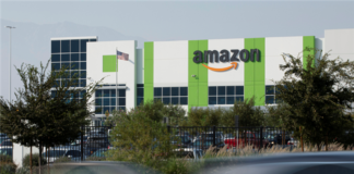 Cars pass by the Amazon distribution warehouse in the industrial area of Fontana, California in the Inland Empire where Secondary Market Rents Soar