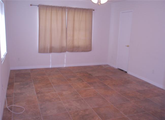 rental renovation tile in Landlord Hank's duplex