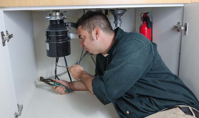 Rental property maintenance: How to troubleshoot a broken garbage disposal